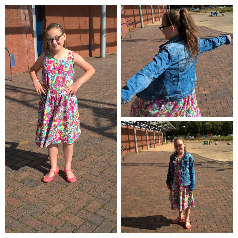 girls day out girl wearing flowery dress and denim jacket outside a building