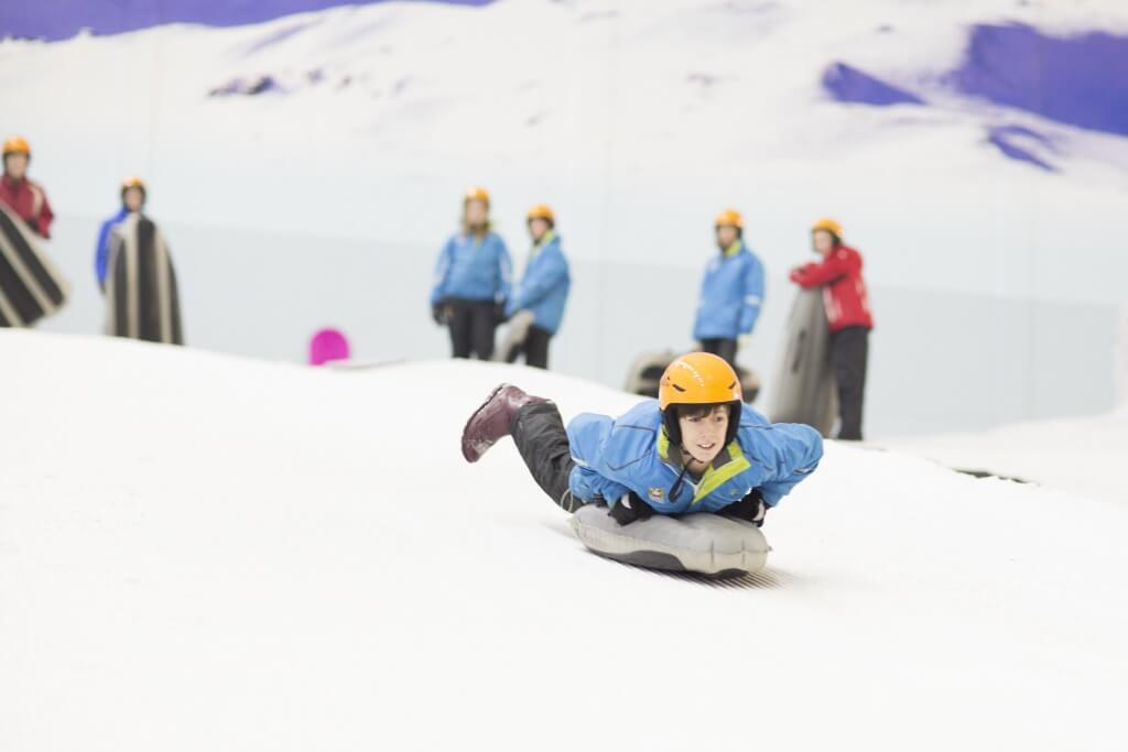 day trip round up promotional picture of sledding fun at chill factore
