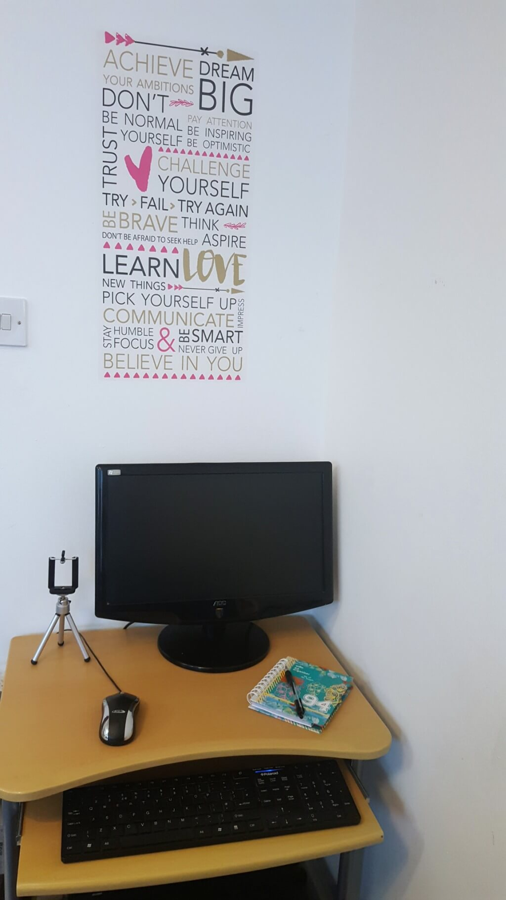 sprucing up my home office picture of a pc on a desk with a wallsticker behind