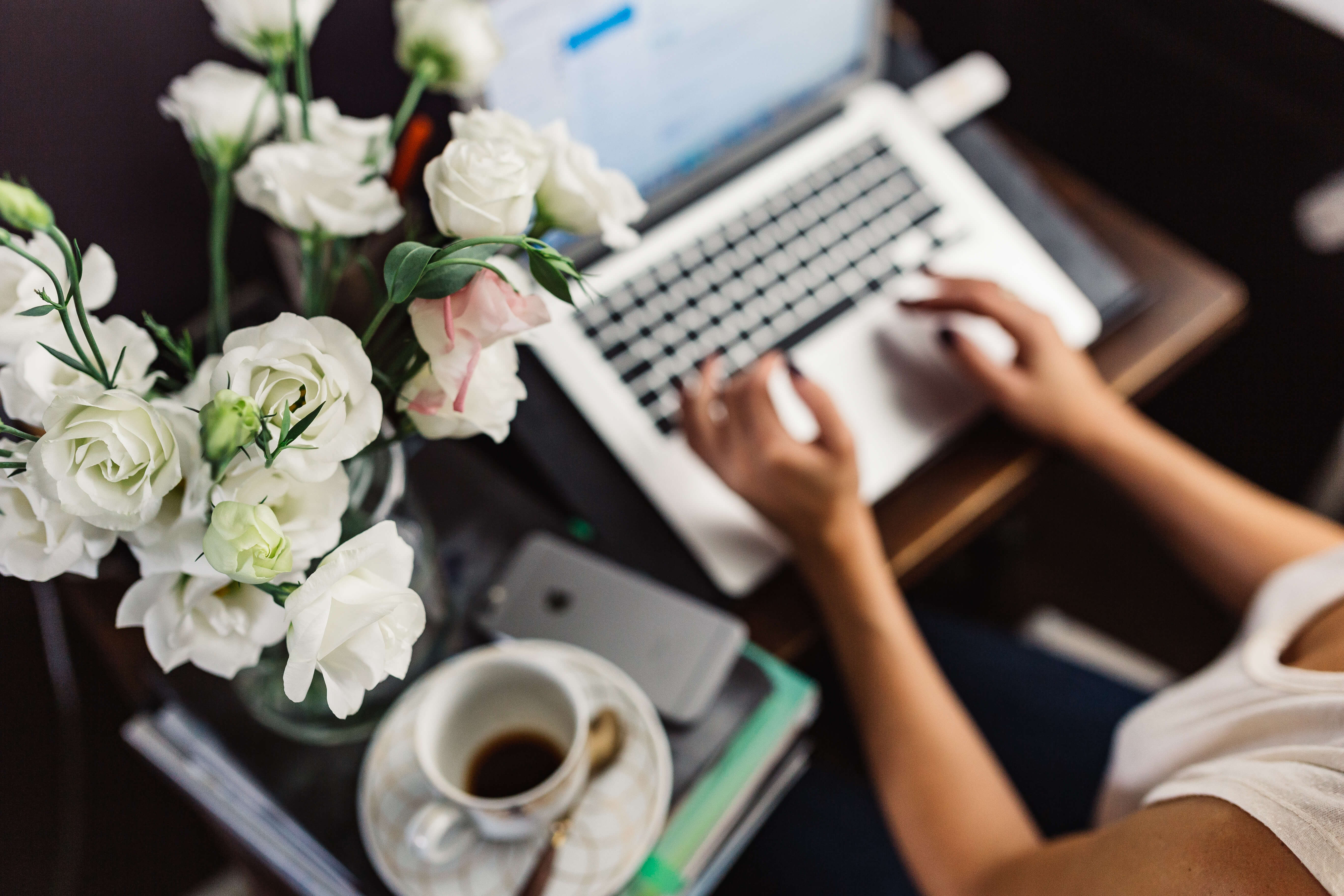 work from home outfits woman at desk with flowers