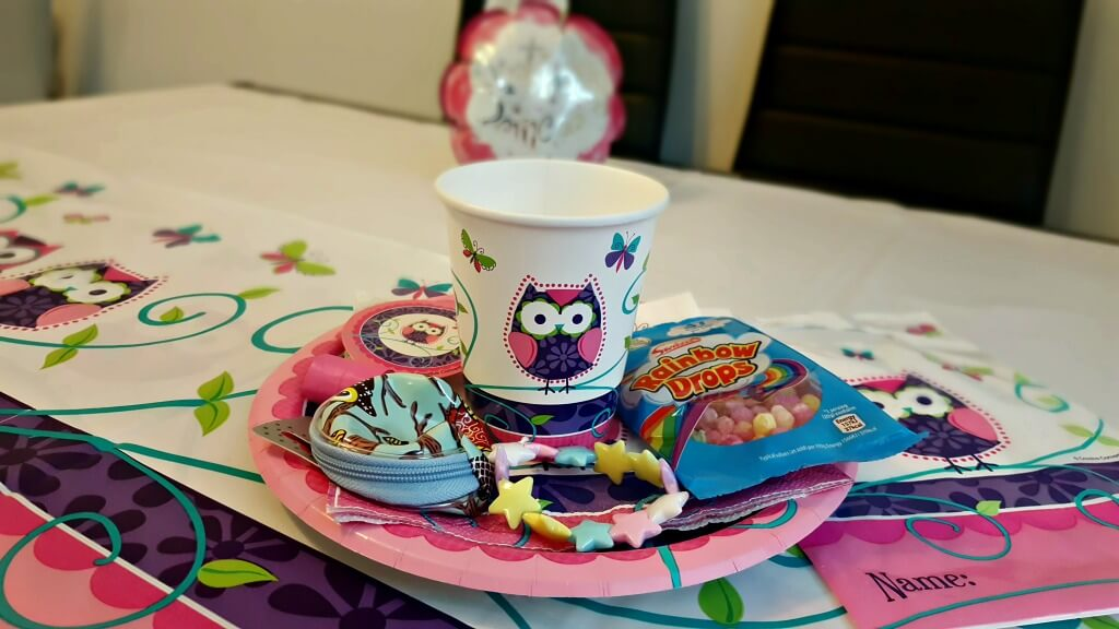 my party bags and supplies review showing a picture of owl design kids partyware with items from a party bag