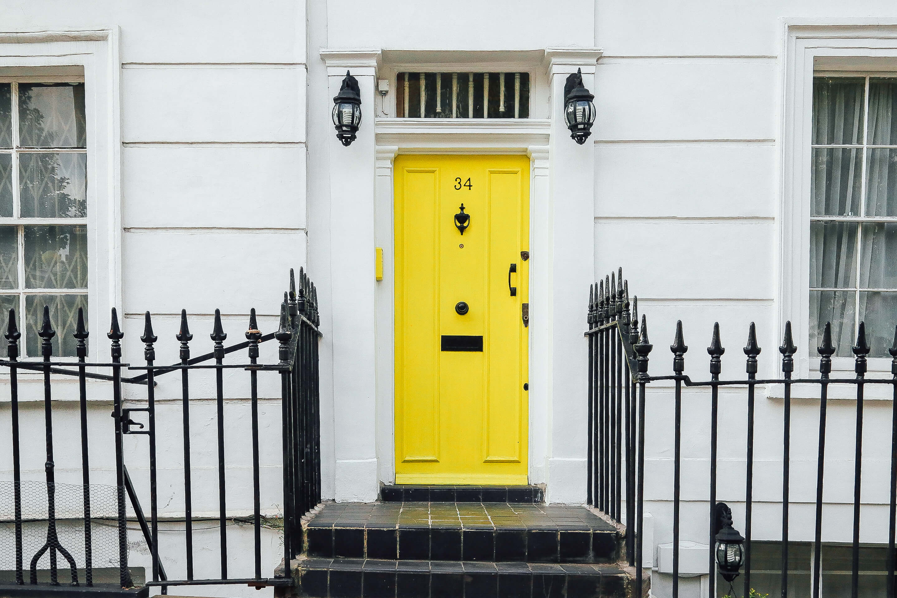 picture of a yellow front door to illustrate being locked out again