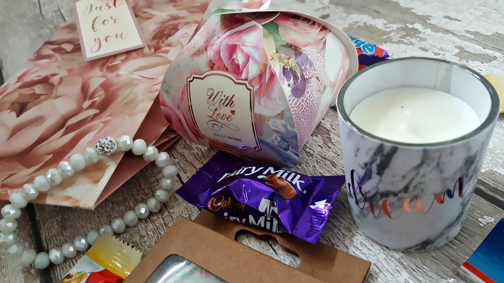 happy aunties day bags contents including a bracelt and bath and candle with gift bag