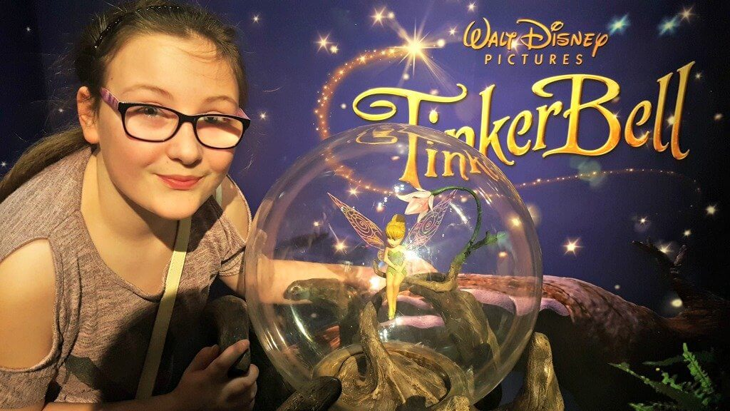 girl next to a waxwork figure of tinkerbell