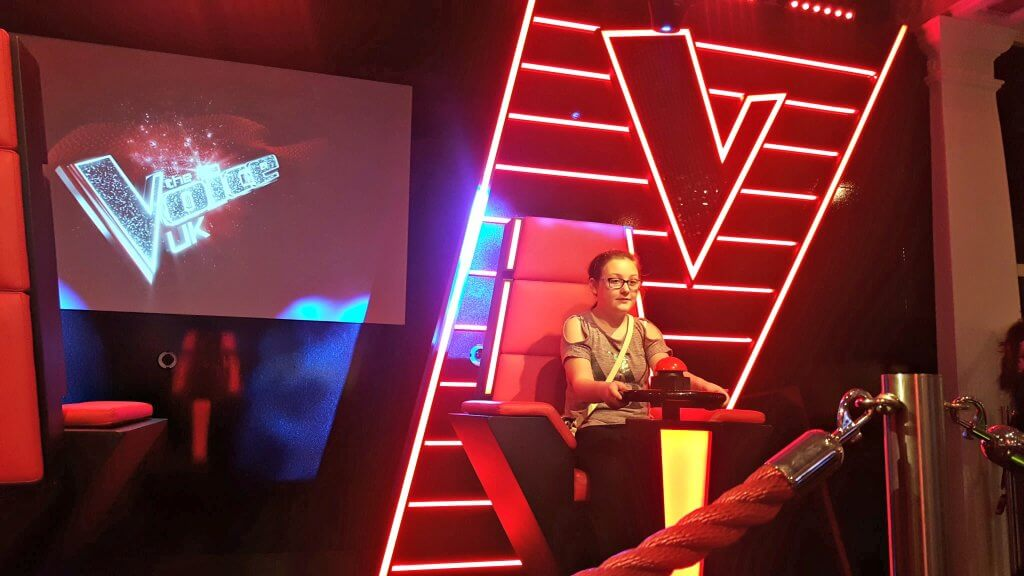 girl sitting in a chair from the voice