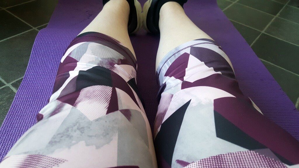 plus size active wear close up of purple and grey patterned capris