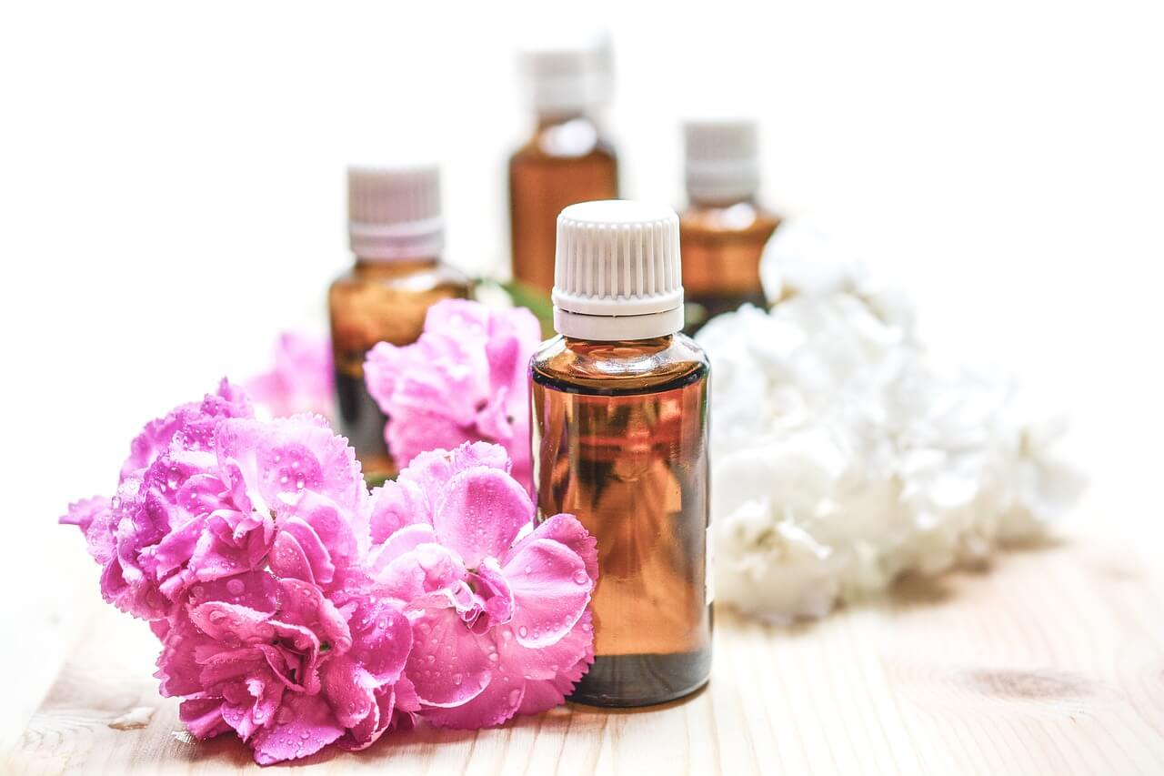 use-essential-oils-oil-bottles-surrounded-by-flowers