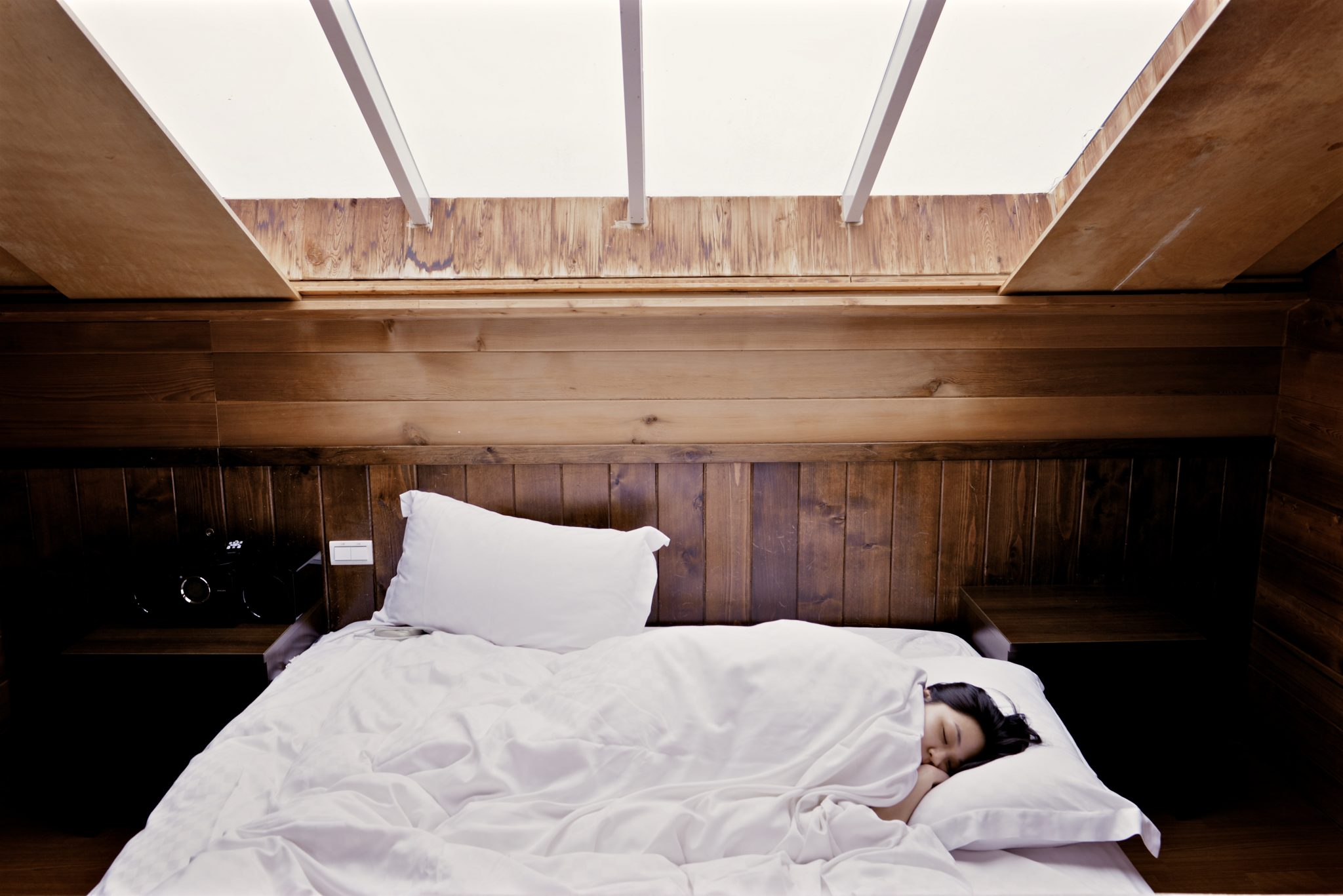 a-woman-sleeping-on-a-bed-sleeping-habits-post