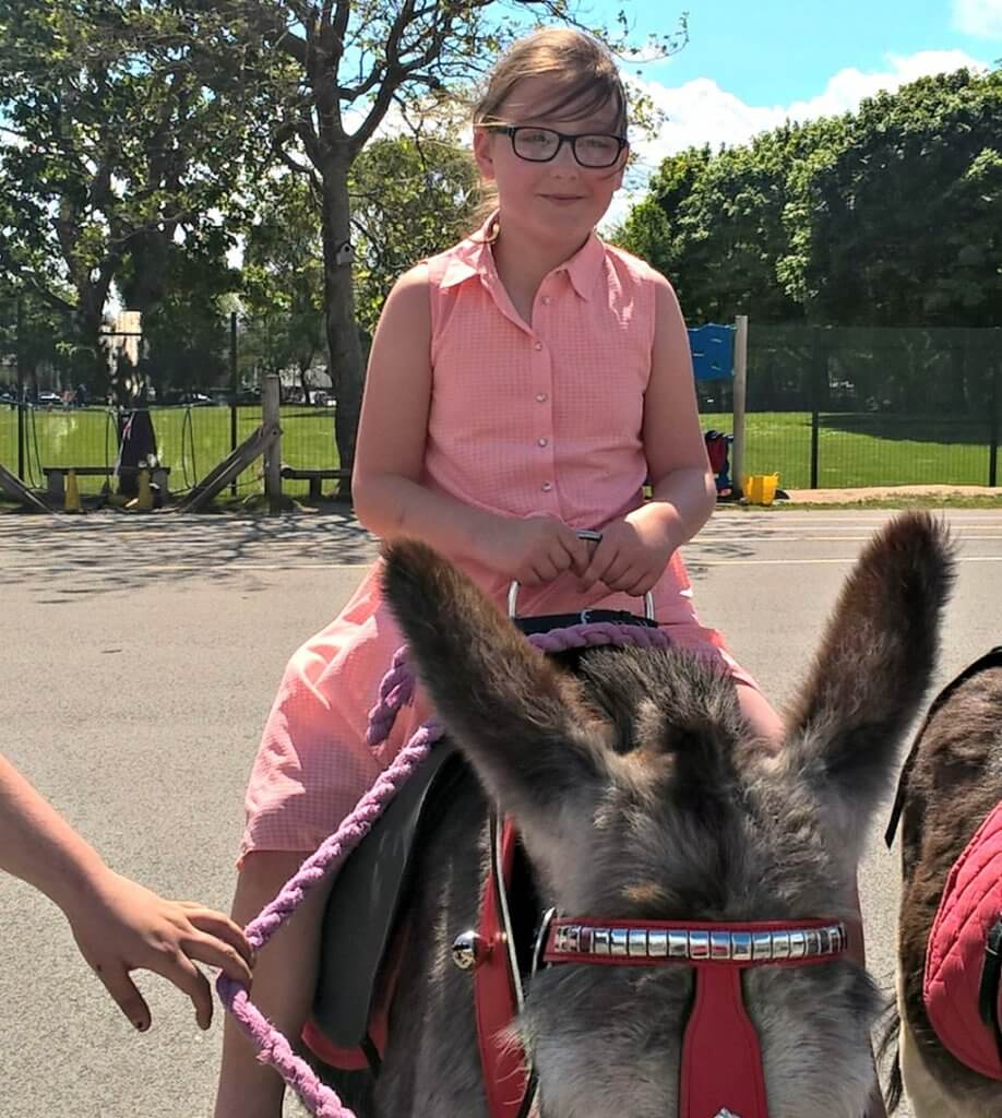 safe-flooring-for-children-outside-girl-on-donkey
