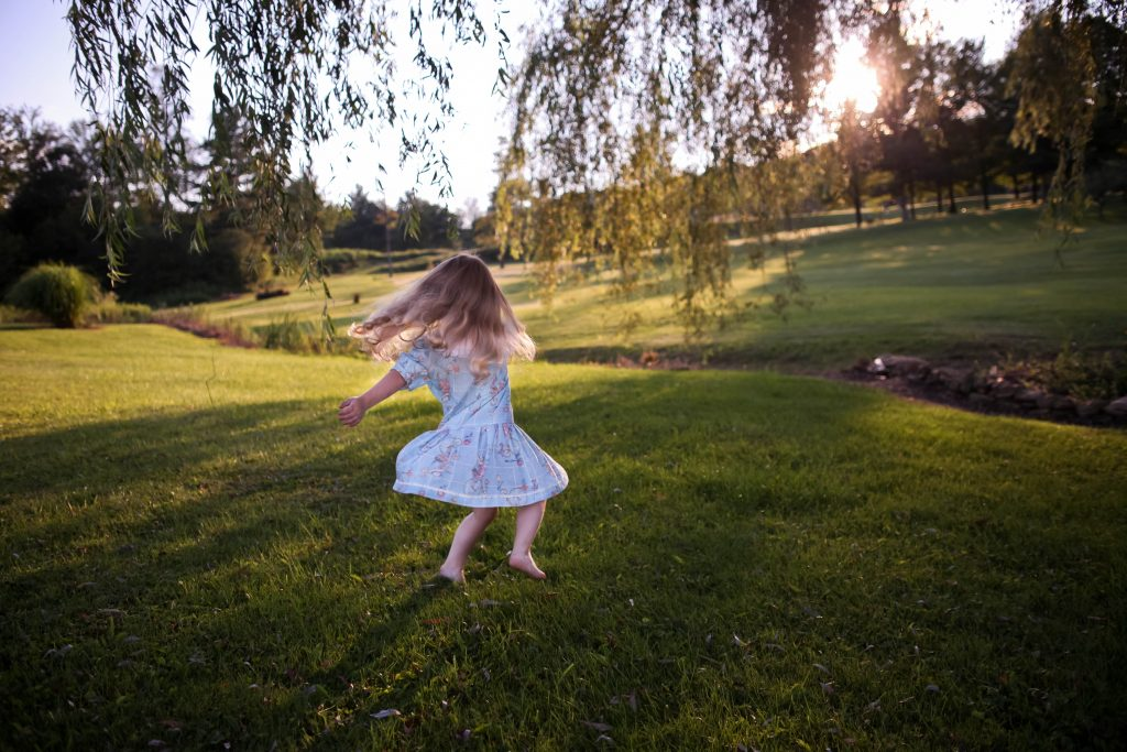 keep-kids-active-girl-dancing-on-grass