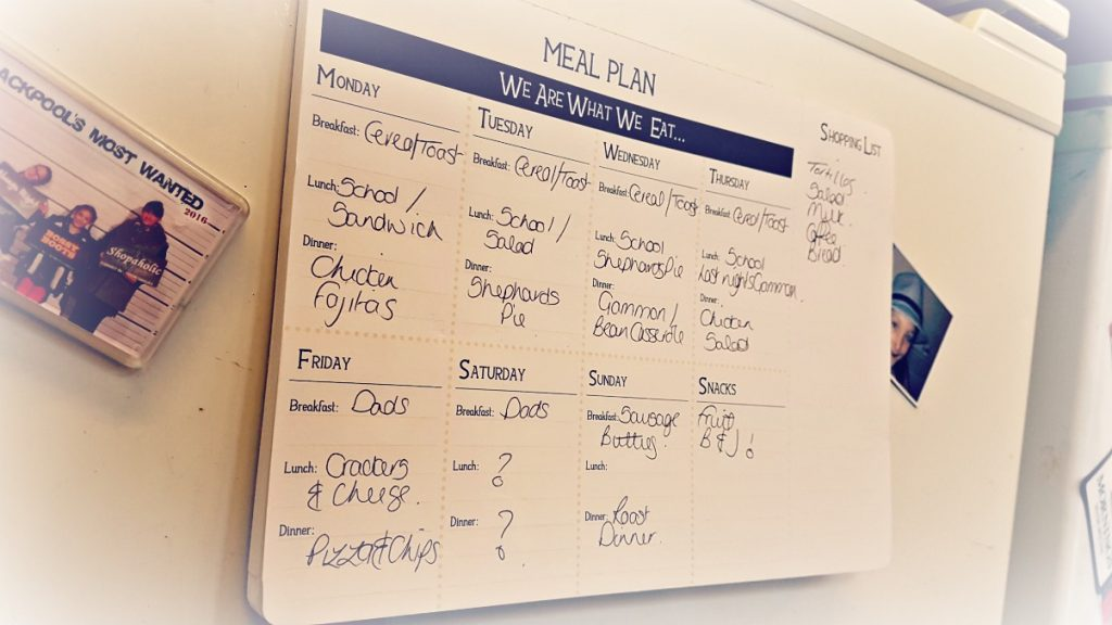 meal planner on fridge to help reduce food waste