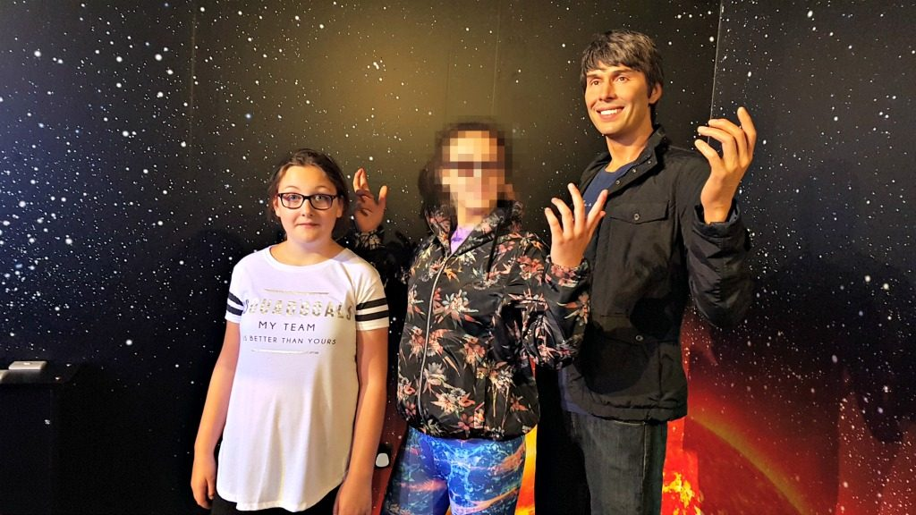 2 girls stood in front of brian cox waxwork at madame tussauds blackpool