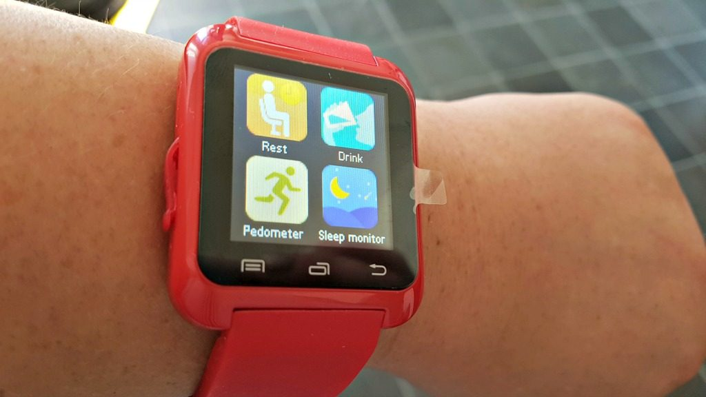 bluetooth smart watch screen with red bracelet