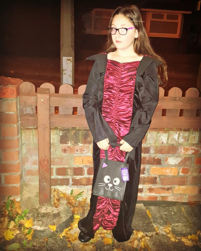 girl wearing a long vampire style dress for halloween