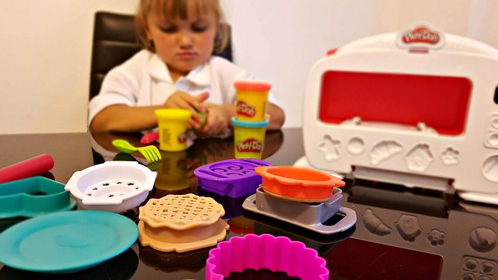 play-doh magical oven - girl playing with play-doh oven and accessories