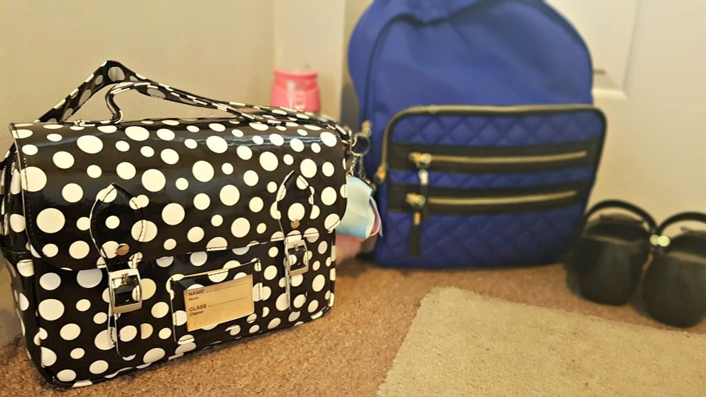 spearmark cool bag and rucksack by a door with school shoes