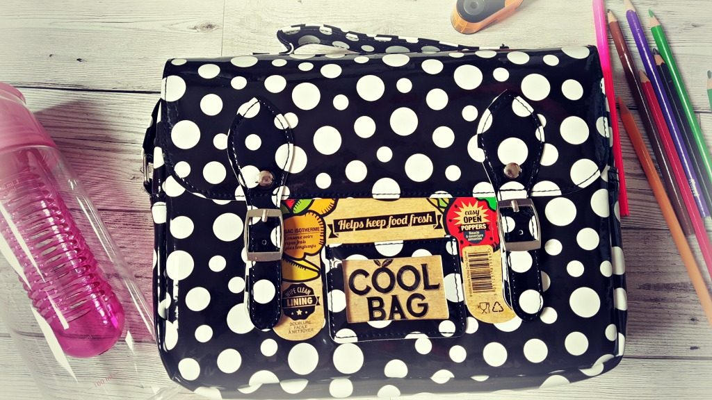 black and white spotty cool bag with school accessories