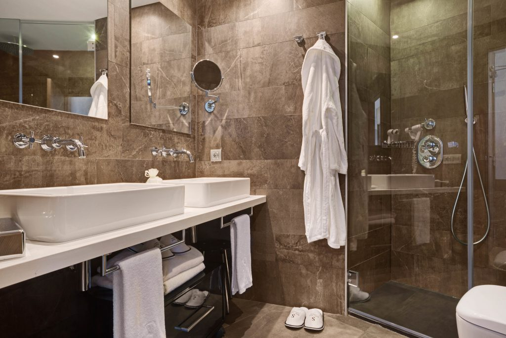 tiled bathroom with walk in shower idea to increase value before selling your home