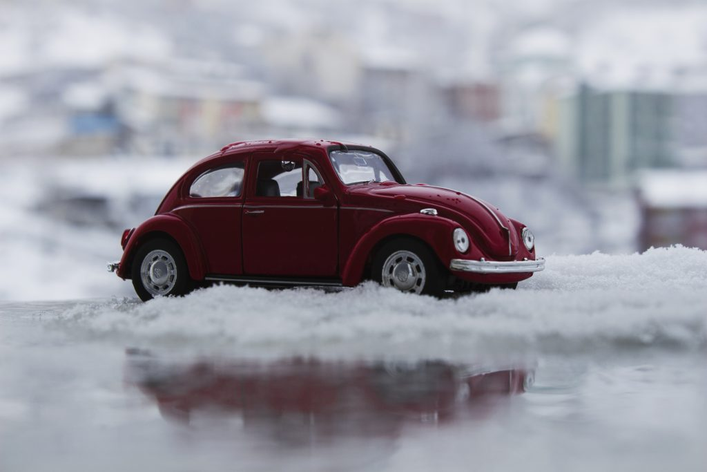 toy car in snow depicting bad weather driving