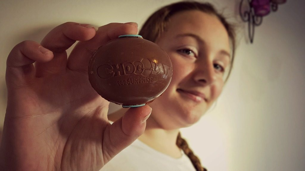 chocolate surprise egg maker review - girl holding completed chocolate egg
