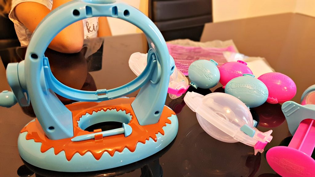 items included in the chocolate egg surprise maker review including stand and multiple moulds