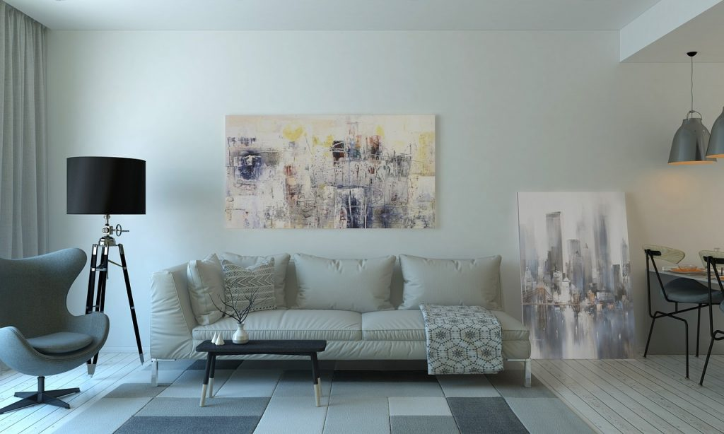living room with white sofa and art work