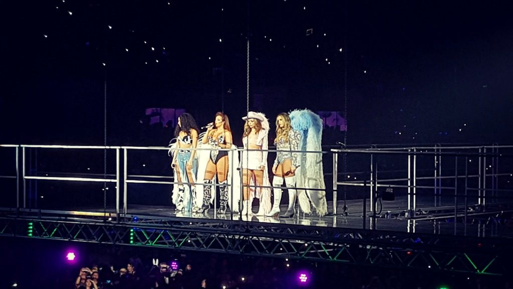 picture of girl group little mix standing on an elevated platform from their liverpool show on 20th november 2017