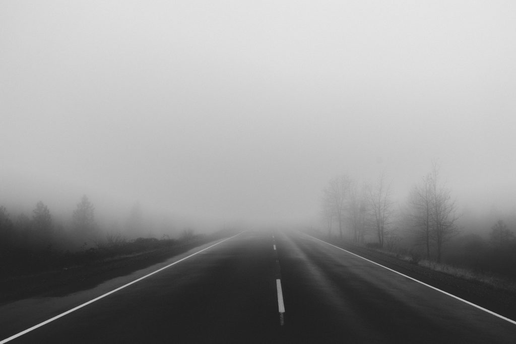 foggy road depicting bad weather driving