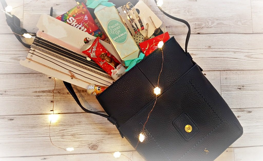 joules navy cross body bag with cohoclates, bath products and jewellery with led snowflake lights