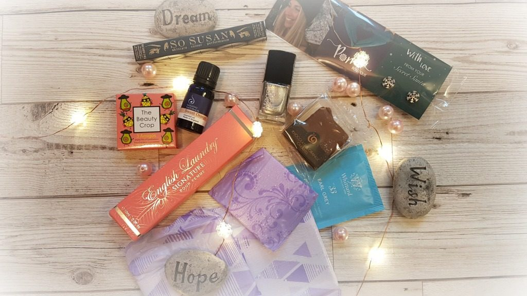 beauty and sweet treats inside pink parcel december edit box