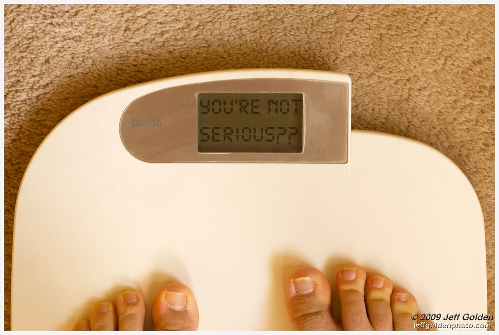 "toes on a white set of scales with the display saying ""you're not serious"""