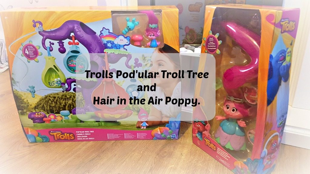 trolls podular troll tree and hair in the air poppy in the boxes withn text over the top of the image
