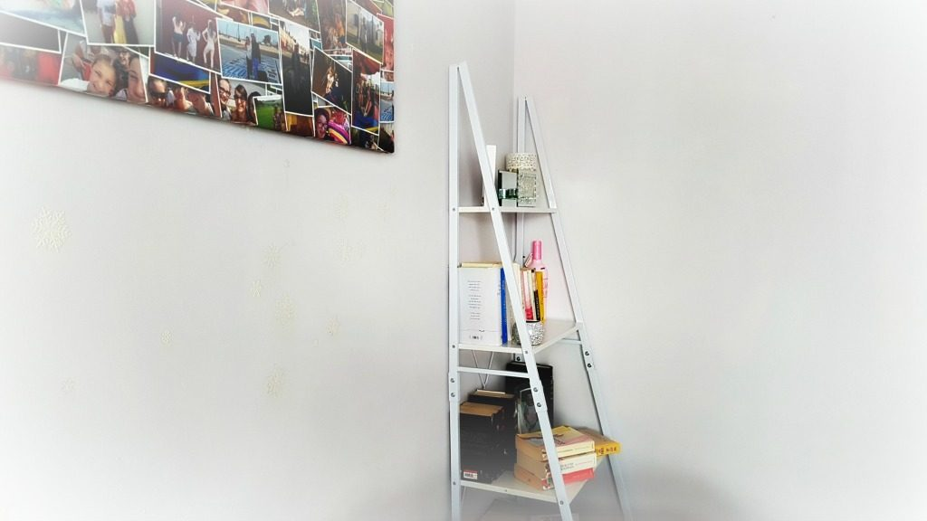 home improvements - white ladder style bookcase with books and decorative ornaments
