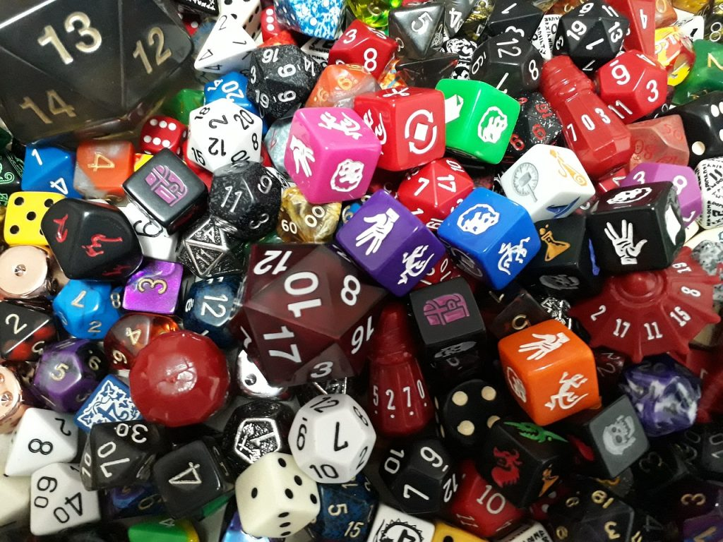 collection of different size and shape dice