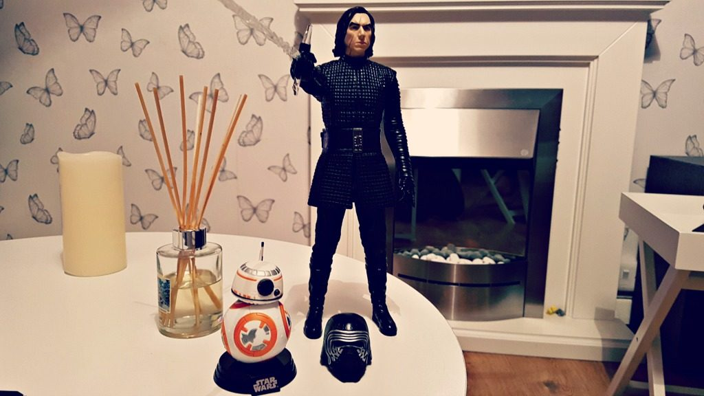 kylo ren interactive figure on a white table with bb-8 figure in front of a white fireplace