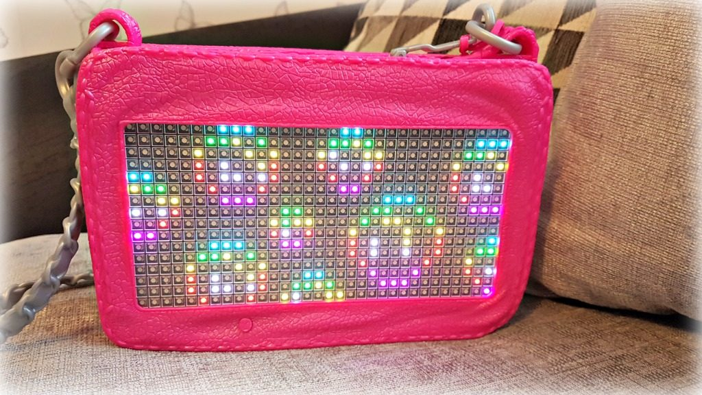project mc2 pixel purse. A pink plastic purse with an led display