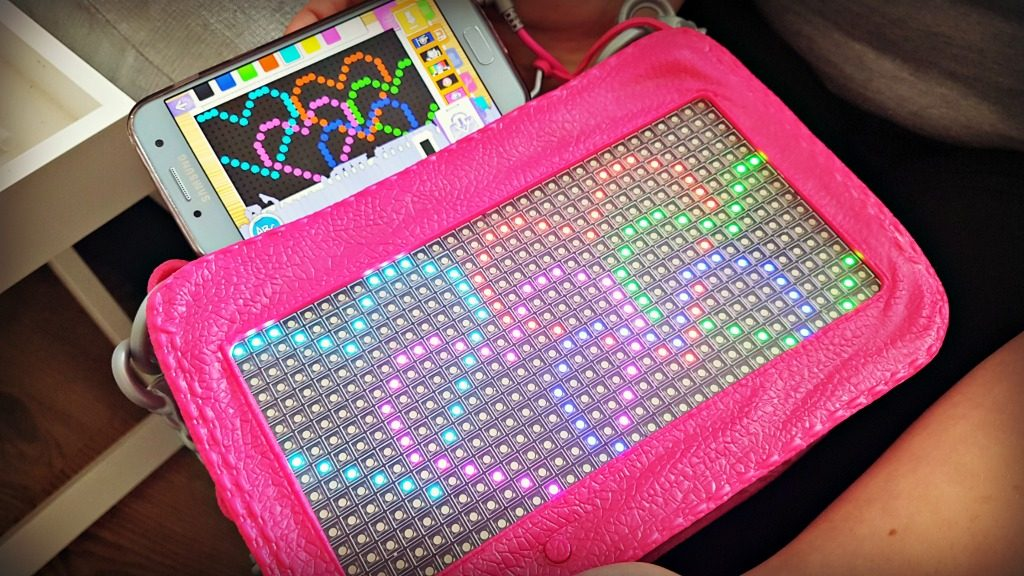 the project mc2 pixel purse showing a pixelated design and the corresponding design as created on an app on a mobile phone