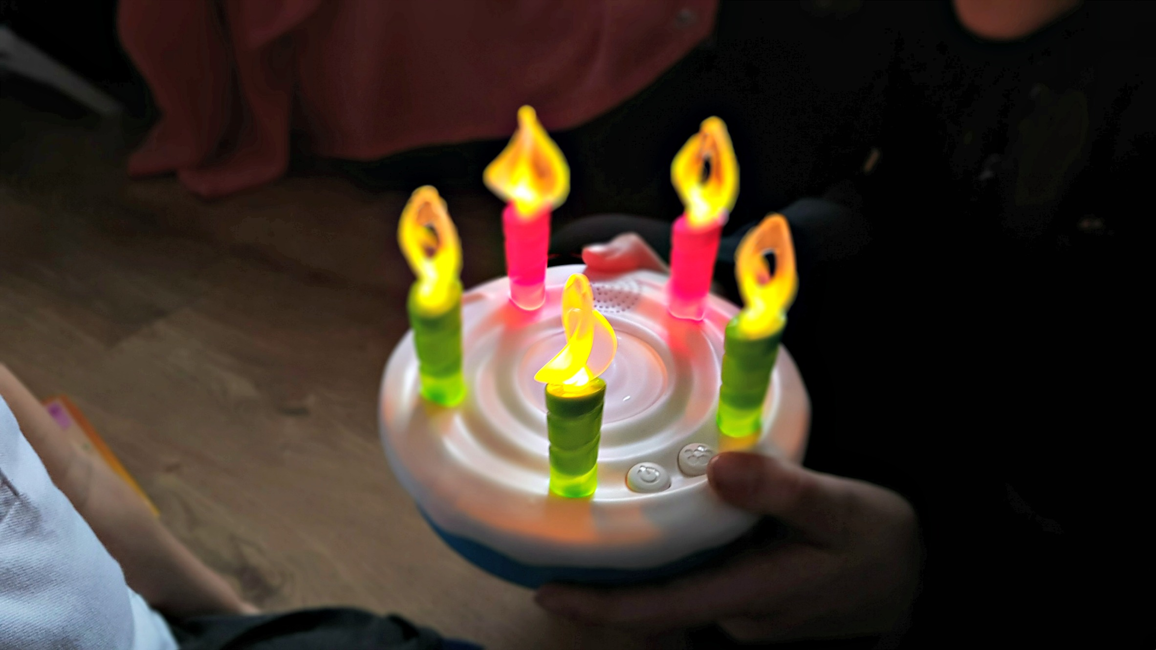 lit up candles on the hasbro birthday blowout game