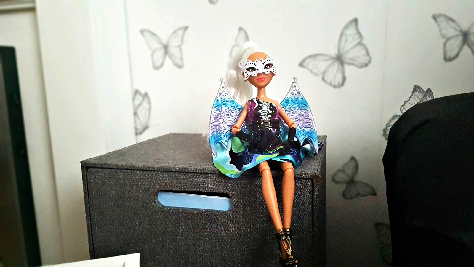project mc2 experiment doll camryn sat on a grey unit