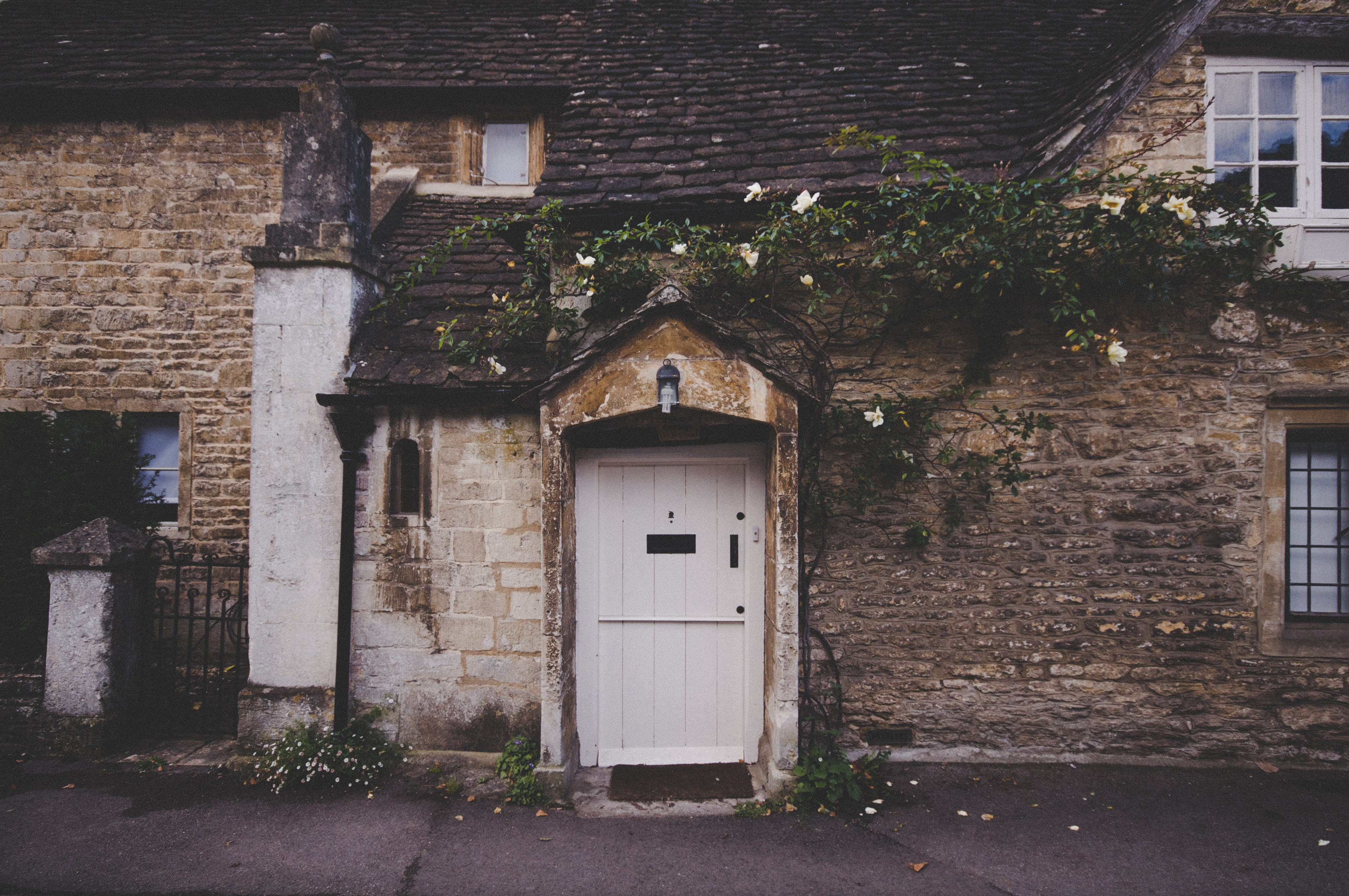outside of a cottage with a white door