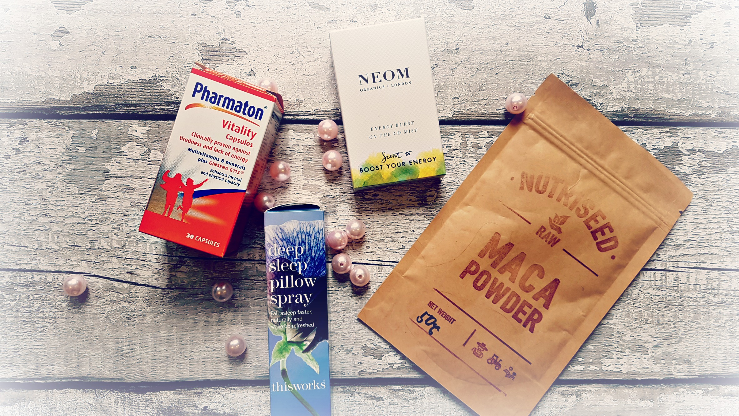 a lfatlay image of pharmaton capsules, sleep spray, maca powder, and neom energising spray