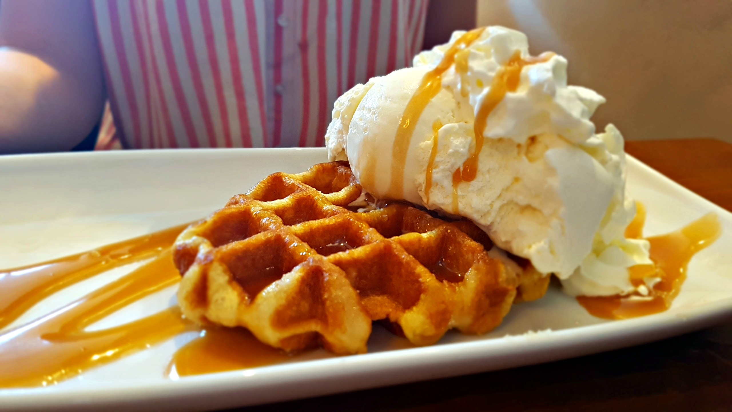 belgium waffle with sauce and vanilla ice cream