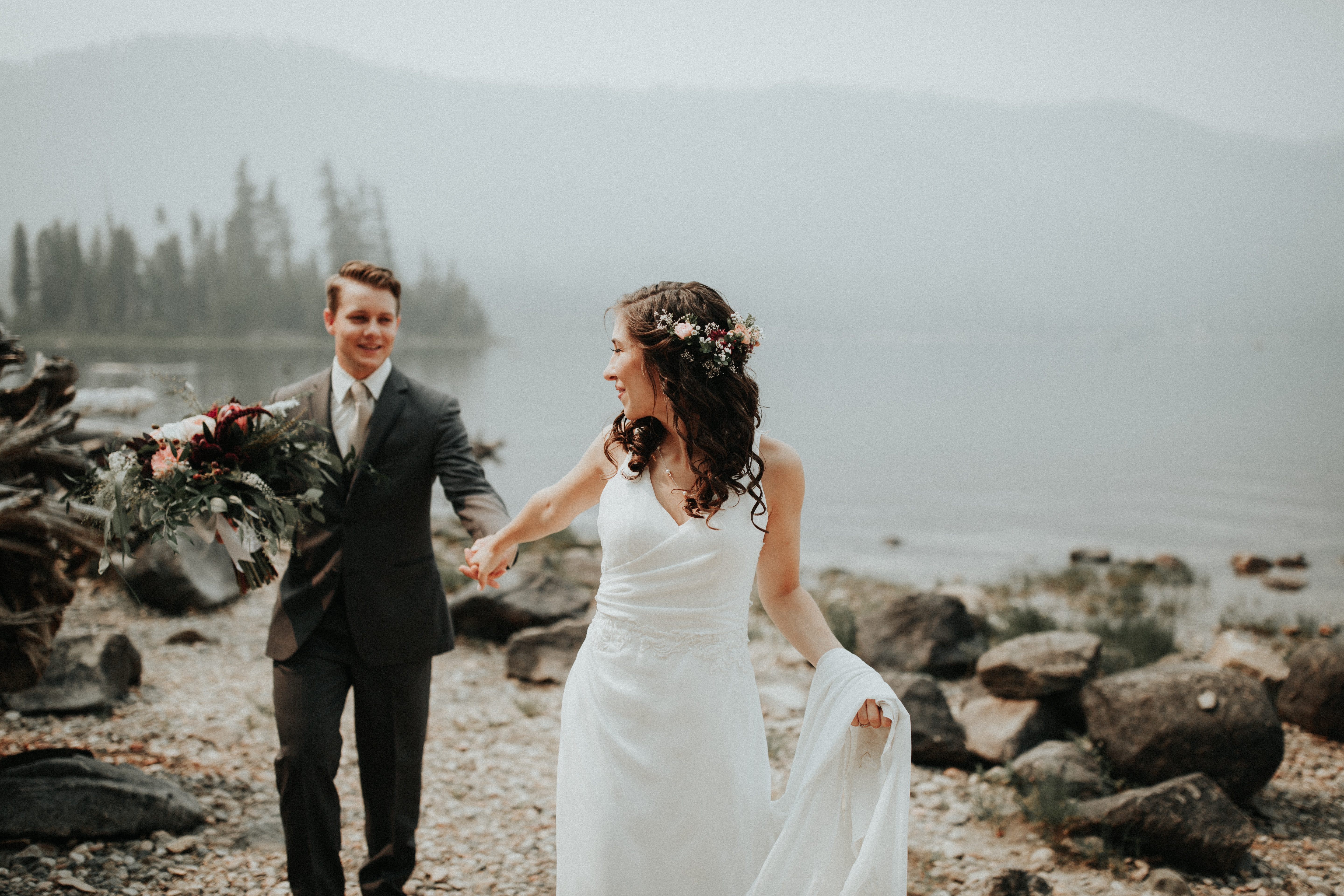 young couple on a beach in wedding dress and tuxedo