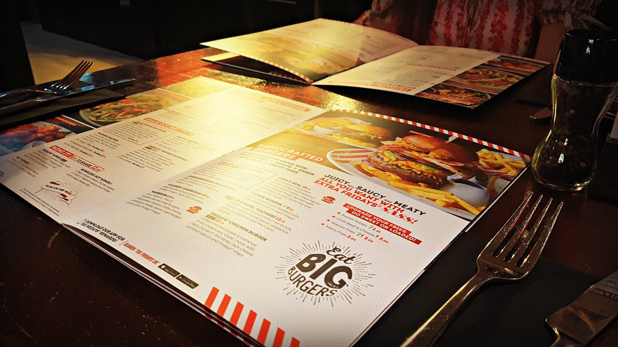 open tgi fridays menu on a table