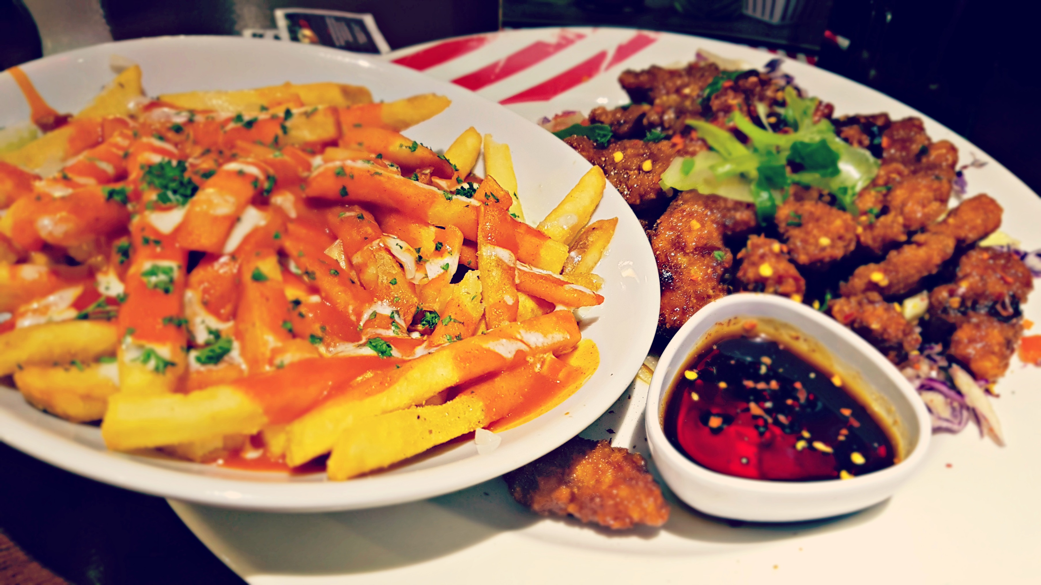 sesame chicken with a bowl of warrior fries from tgi fridays