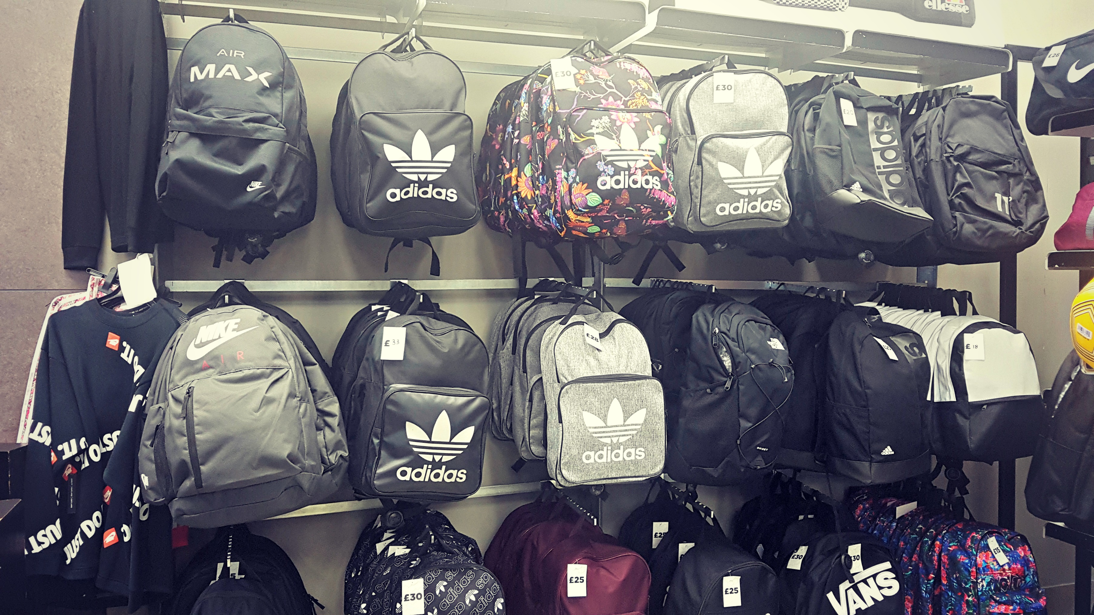 a wall display of backpacks at jd sports coliseum shopping park