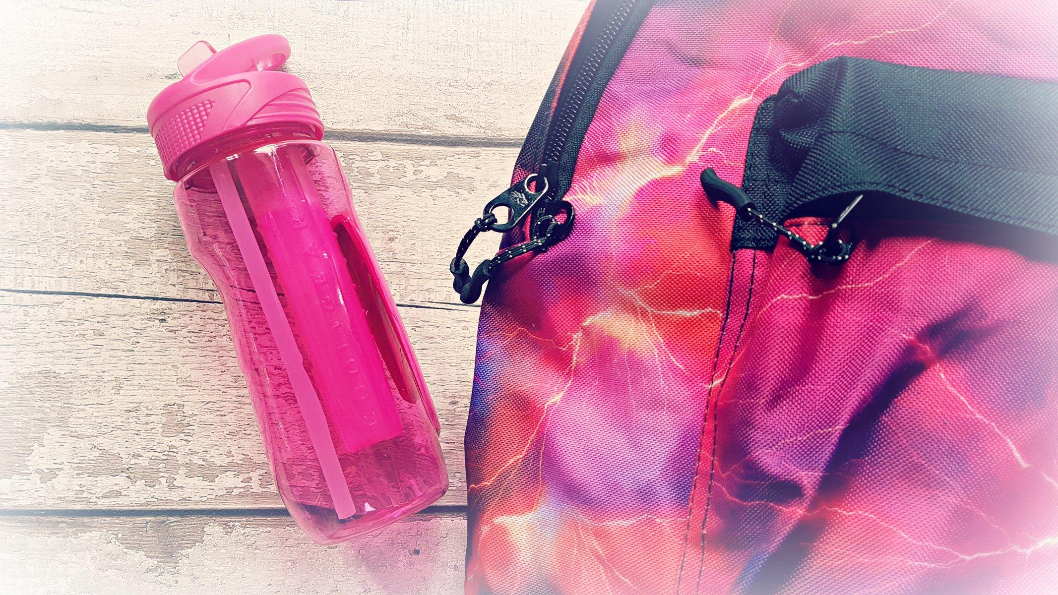 a pink lightening design backpack and a pink drink bottle