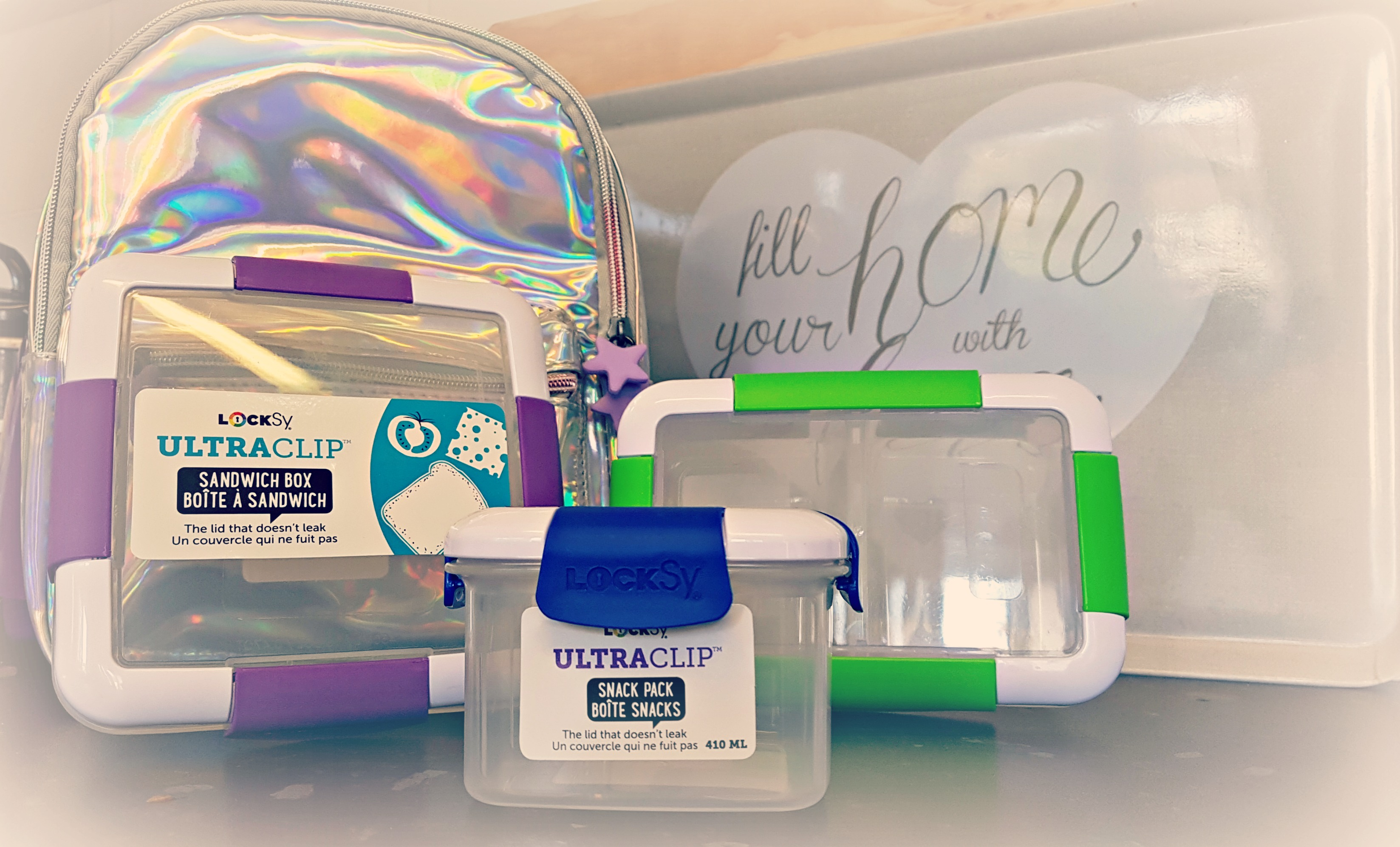 a holographic mini back pack with a selection of tupperware from spearmark locksy ultra clip