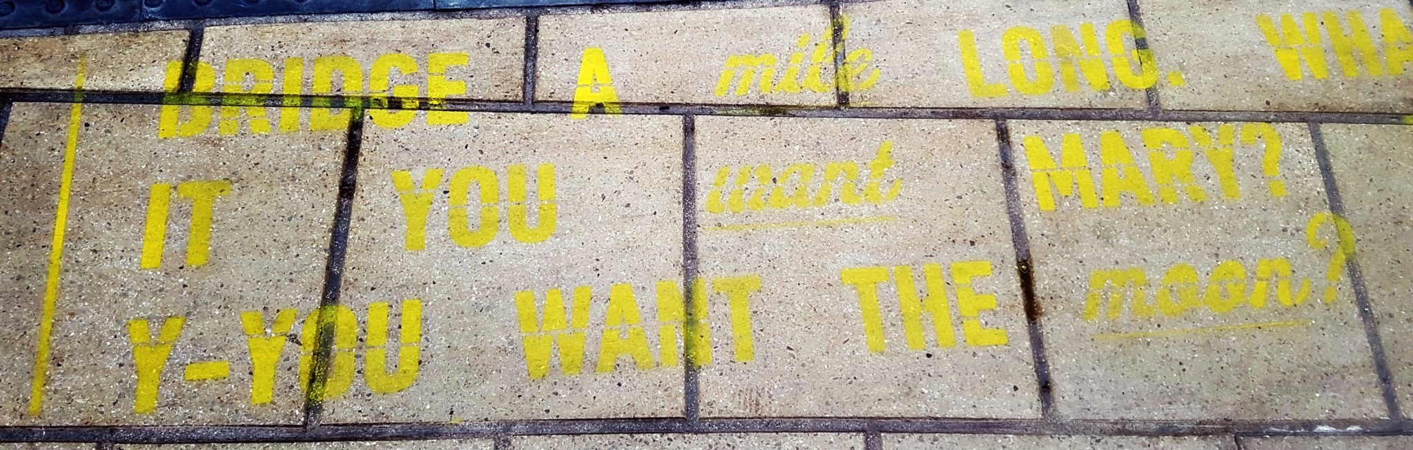 a train platform with quotes from its a wonderful life in yellow paint along lime street station