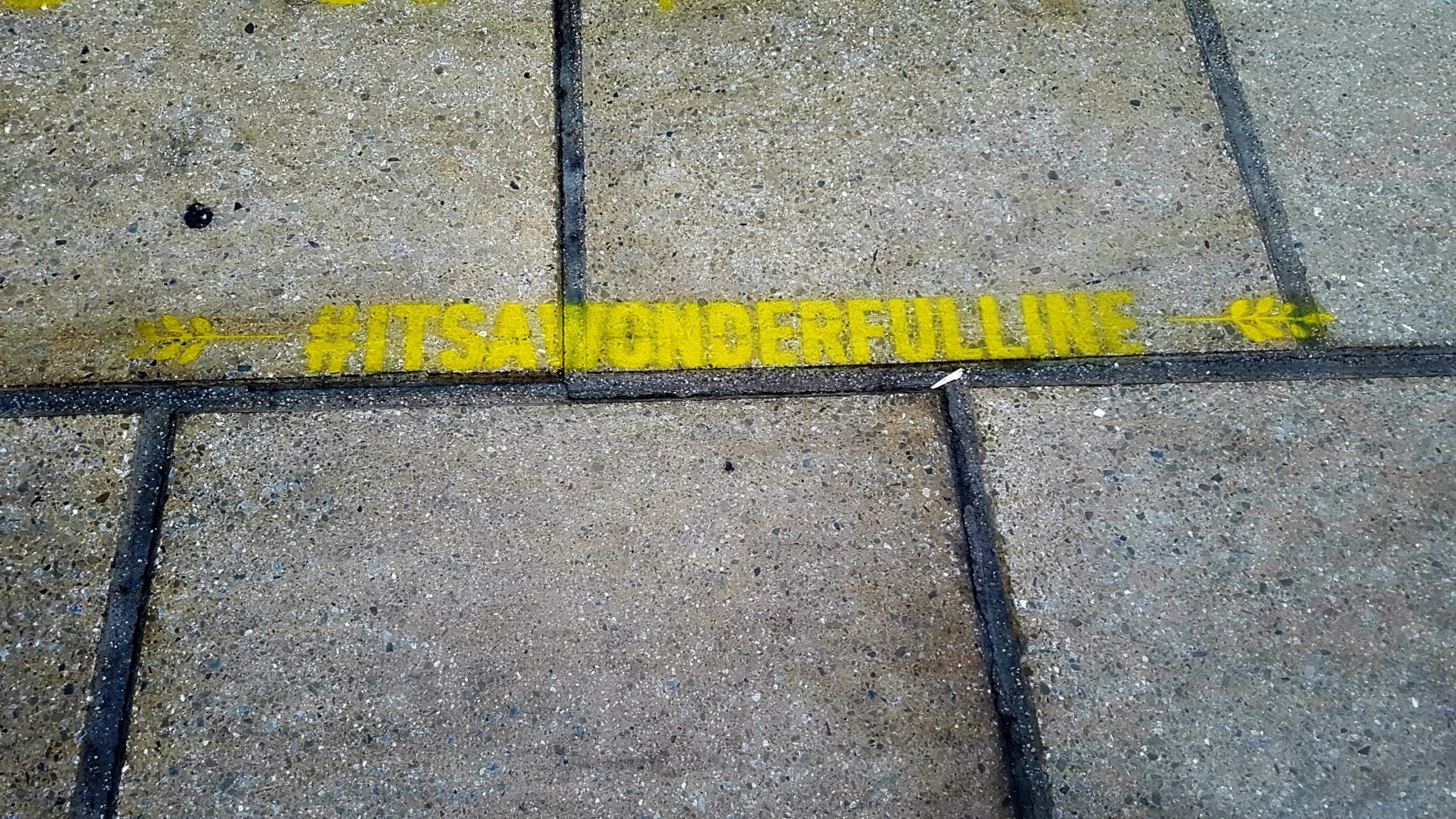 #itsawonderfulline in yellow paint on a train platform at liverpool lime street